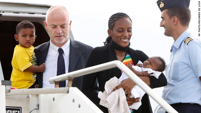 "JULY 24 - CIAMPINO AIRPORT, ITALY: Meriam Ibrahim disembarks an aircraft with her children Maya, in her arms, and Martin, and is greeted by Italian deputy Foreign Minister Lapo Pistelli, after departing from Khartoum. The Sudanese woman was sentenced to death in her country for refusing to renounce her Christian faith and gave birth to Maya in prison. Ibrahim <a href='http://cnn.com/2014/07/24/world/europe/italy-sudan-christian-woman/index.html'>""will remain in Italy for a short time and then will travel on to the United States,""</a> the Italian Foreign Ministry said."