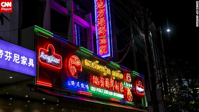"Neon seems to be a requirement for <a href='http://ireport.cnn.com/docs/DOC-1152834'>Chinese and seafood restaurants</a> in Phnom Penh, joked Heston, who has lived there for more than a decade. ""Brilliant displays of Khmer, Chinese and English script as well as an assortment of lobster, shrimp, crab and fish adorn the signs of these restaurants that do a great deal of trade,"" he said."