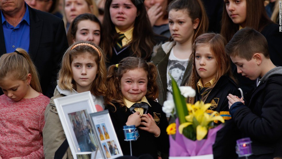 Mourners in Eynesbury, Australia, attend a memorial service Sunday, July 20, for a family of five killed aboard Malaysia Airlines Flight 17. Johannes van den Hende, Shalize Zain Dewa and their children -- Piers, Marnix and Margaux -- were on the passenger plane last week when <a href='http://www.cnn.com/2014/07/18/world/gallery/malaysia-airlines-reaction/index.html'>it was shot down</a> over Ukraine. All 298 people aboard the flight were killed.