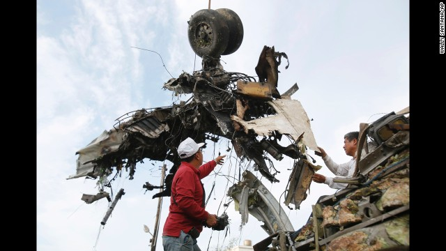 Emergency workers remove the wreckage on July 24.