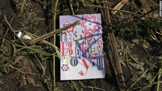 A birthday card found in a sunflower field near the crash site of Malaysia Airlines Flight 17 in eastern Ukraine, on Thursday, July 24. The passenger plane was shot down July 17 above Ukraine. All 298 people aboard were killed, and much of what they left behind was scattered in a vast field of debris.