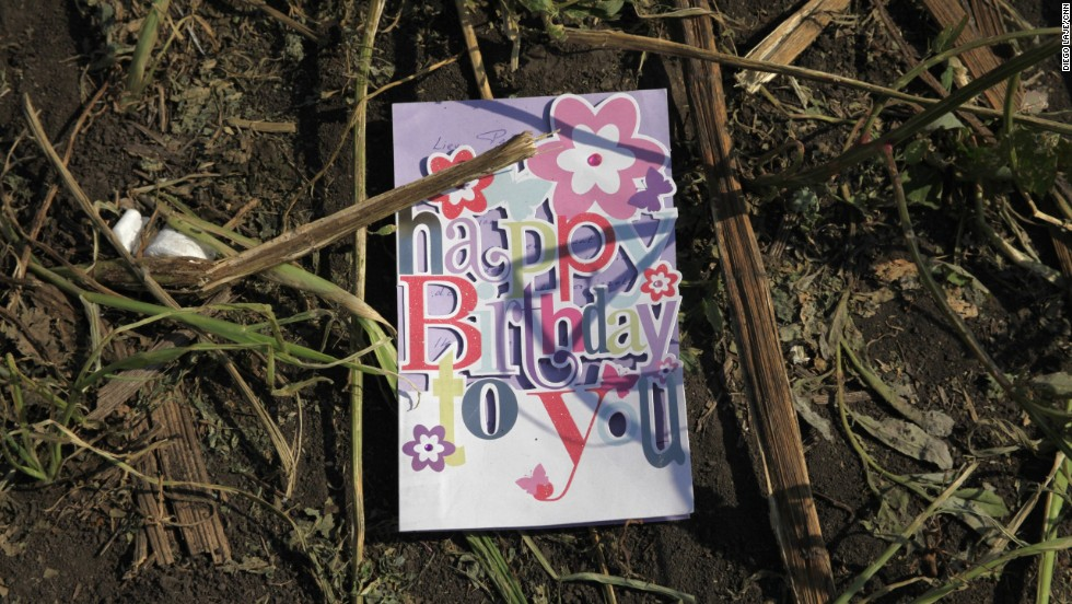 A birthday card found in a sunflower field near the crash site of <a href='http://www.cnn.com/specials/world/mh17-specials-page/index.html' target='_blank'>Malaysia Airlines Flight 17</a> in eastern Ukraine, on Thursday, July 24. The passenger plane was shot down July 17 above Ukraine. All 298 people aboard were killed, and much of what they left behind was scattered in a vast field of debris.