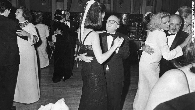 "You don't hear much about ""society"" anymore, but it still mattered in the '60s when Truman Capote (center) mixed socialites and celebrities with his 1966 Black and White Ball. Held in honor of the Washington Post's Katharine Graham -- pictured on the far left -- it was more of an excuse for a Capote party. The 500 attendees included Frank Sinatra, CBS founder William Paley, Lauren Bacall -- pictured on the far right dancing with choreographer Jerome Robbins -- three presidential daughters and Capote's elevator man. It was both a throwback to the swell soirees of the past and a precursor to the media-mad, celebrity-studded bashes of today."