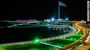 The flag of Azerbaijan blows in the wind above the country's capital city of Baku.