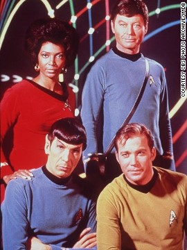 Nichols on set with (clockwise) DeForest Kelley, William Shatner, and Leonard Nimoy.