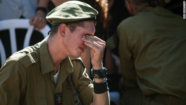 An Israeli soldier mourns at the grave of reserve Master Sgt. Yair Ashkenazy during his funeral at the military cemetery in Rehovot, Israel, on Friday, July 25. Ashkenazy was killed during operations in northern Gaza, the Israel Defense Forces reported.