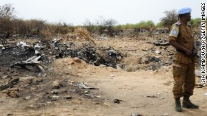 A U.N. soldier stands at the crash site of the Air Algerie Flight AH 5017 in Mali's Gossi region, west of Gao, on Saturday, July 26. A U.N. spokeswoman says that the seconf flight data recorder was recovered on Saturday.