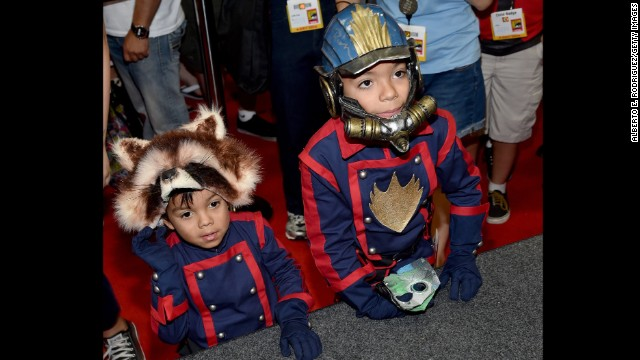 "Two young fans dressed as Rocket Raccoon and Star-Lord from Marvel's ""Guardians of the Galaxy"" attend the convention."