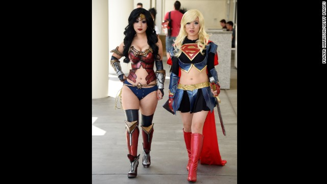 Two attendees cosplay Wonder Woman and Supergirl on July 26. Cosplayers wear costumes of their favorite characters.