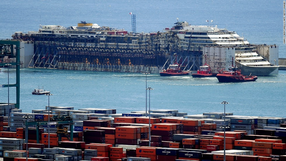 The refloated wreck of the Costa Concordia is towed to the Italian port of Genoa on Sunday, July 27, to be scrapped, ending the ship's final journey two and a half years after it capsized at a cost of 32 lives.