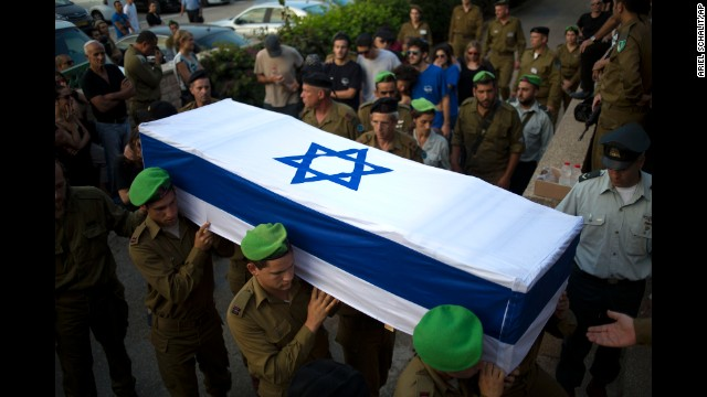 Israeli soldiers carry the coffin of 2nd Lt. Roy Peles, an infantry officer who was killed in combat, during his funeral in Tel Aviv on Sunday, July 27.