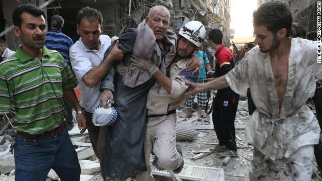 People carry an injured man away from the site of an airstrike, reportedly carried out by Syrian government forces, in Aleppo, Syria, on Sunday, July 27. The United Nations estimates more than 100,000 people have been killed in Syria since an uprising in March 2011 spiraled into civil war.