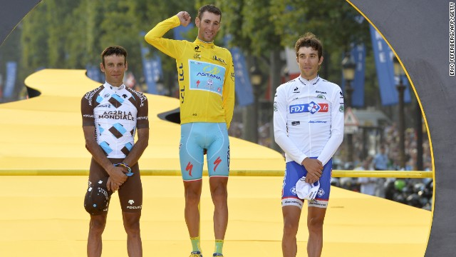 France's Jean-Christophe Peraud (left) and Thibaut Pinot flank winner Vincenzo Nibali of Italy on the podium for the 2014 Tour de France.