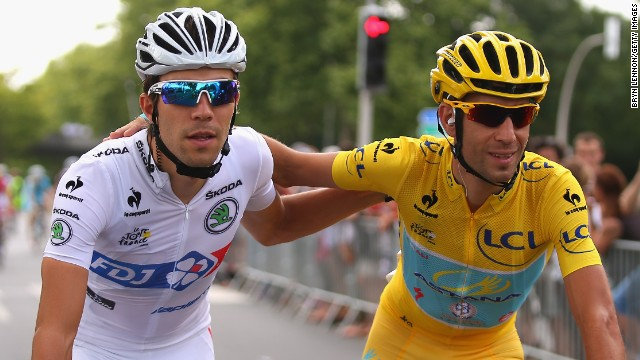 Pinot and yellow jersey winner Nibali share a moment during the 21st and final stage of the Tour de France.