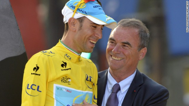 Nibali is congratulated by Hinault on the podium in the Champs-Elysees.