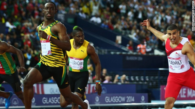 Kemar Bailey-Cole crests the tape ahead of Adam Gemili of England to take the Commonwealth Games 100 title.