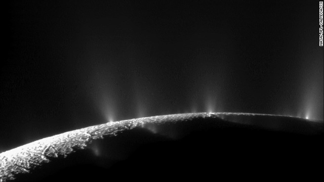 Plumes of water ice and vapor shoot up from the surface of Saturn's moon Enceladus in this two-image mosaic taken by NASA's Cassini spacecraft in November 2009. Analysis by NASA scientists indicates that water can reach the Saturnian moon's surface.