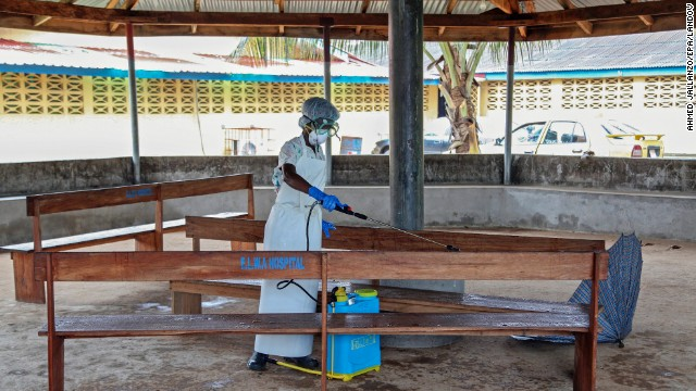 A nurse disinfects the waiting area at the ELWA Hospital in Monrovia, Liberia, on Monday, July 28. Health officials say an Ebola outbreak centered in West Africa is the deadliest ever. As of July 23, 1,201 people in Guinea, Sierra Leone and Liberia are thought to have been infected by Ebola since its symptoms were first observed four months ago, according to the World Health Organization.