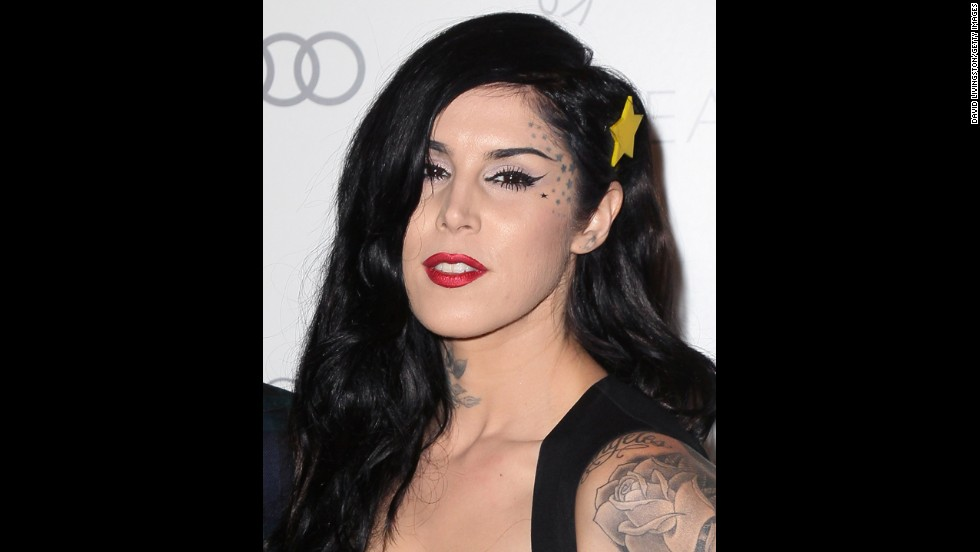 "TV personality and tattoo artist Kat Von D is part of the growing number of celebrities with highly visible tattoos. In her autobiography she calls her body the ""canvas"" of her experiences."