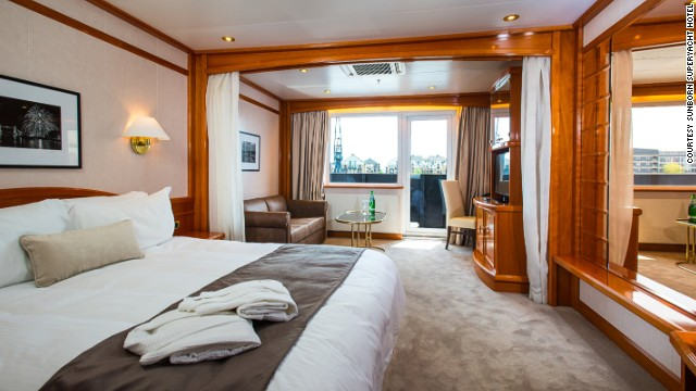 At $300 to $1,600 per night, guests will need deep pockets to wake up with water views. Beside each bed is a tablet for contacting the on-board chef, choosing between foam or feather pillows, and checking live arrival and departure times at nearby City Airport.