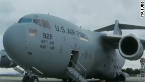 Stowaway's body found in Air Force plane