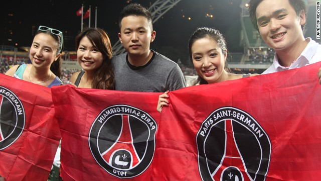 PSG fans welcome their team to Hong Kong Stadium for a friendly match against local champion Kitchee.
