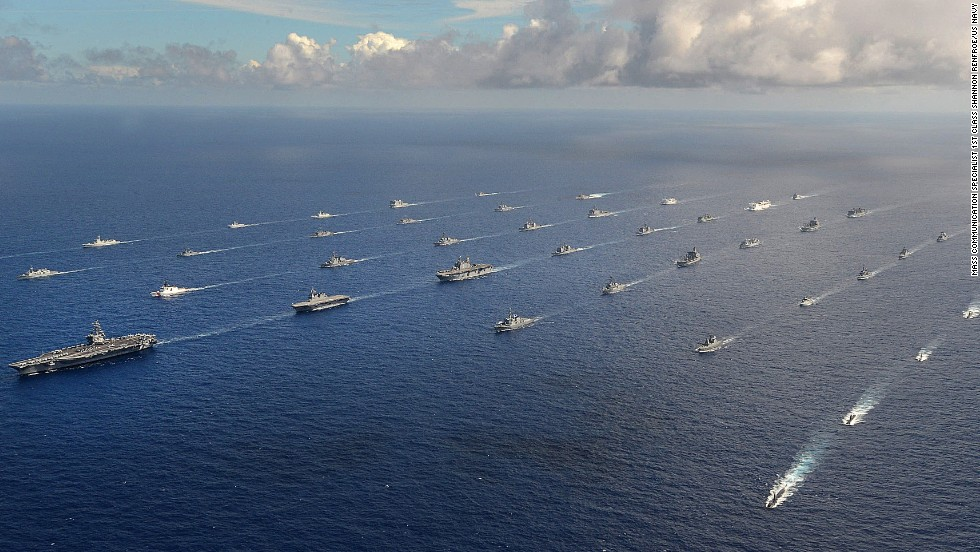 Forty-two ships and submarines representing 15 partner nations maneuver at a close formation during the Rim of the Pacific, or RIMPAC, exercise Friday, July 25. The exercise, which originated in 1971 and has been held every two years since 1974, is the world's largest international maritime exercise, according to the U.S. Navy's Pacific Fleet. This year, 55 vessels, 200 aircraft and 25,000 personnel participated. The 37-day exercise ends Friday.
