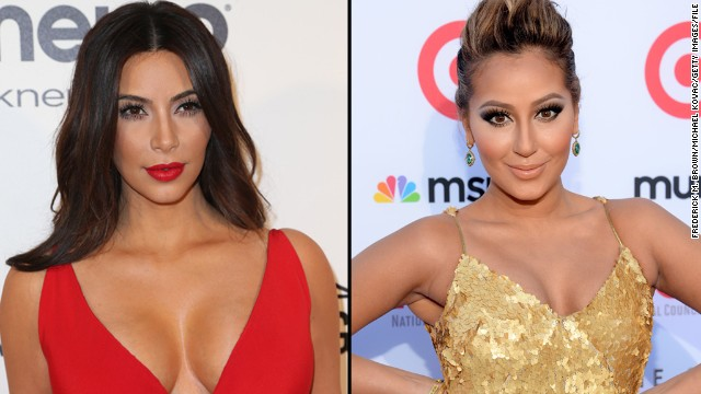 "Kim Kardashian didn't mention actress Adrienne Bailon by name when she went on a Twitter rant July 29, but it was pretty obvious whom she was speaking of. Bailon, who used to date Kim's brother Rob, spoke ill of the past relationship in a magazine interview. Kim then tweeted, ""Funny how she says being with a Kardashian hurt her career yet the only reason she has this article is bc she is talking about a Kardashian ... So sad when people try to kick my brother when he is down #FamilyForever."""