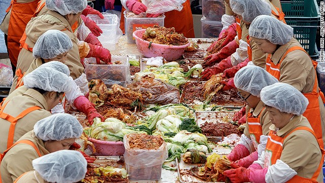 """Kimchi -- a clashing of cultures and colors. Korea and Japan's spat over the dish heated up in 1996 when Japan proposed designating Japanese kimchi, called """"kimuchi,"""" an official Atlanta Olympic food."""