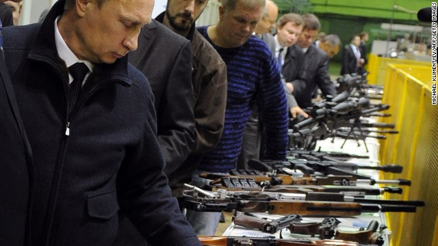 The EU has now issued an embargo on arms exports to Russia as part of its sanctions over the crisis in Ukraine. Pictured here is Russian President Vladimir Putin in an arms factory in Izhevsk.