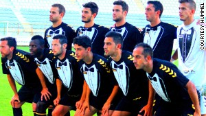 Cultural y Deportivo Leonesa line up in their tuxedo kit.
