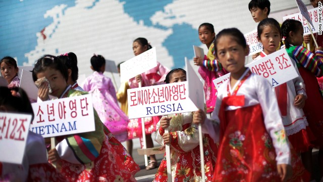 North Korean girls welcome students from participating countries during an opening ceremony at the Songdowon International Children's Camp on July 29, 2014.