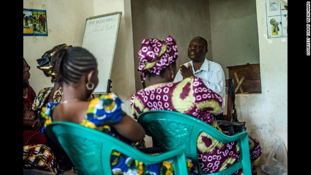 Dr. Mohamed Vandi, from the Kenema Government Hospital, trains community volunteers who will aim to educate people about Ebola in Sierra Leone, on July 10.
