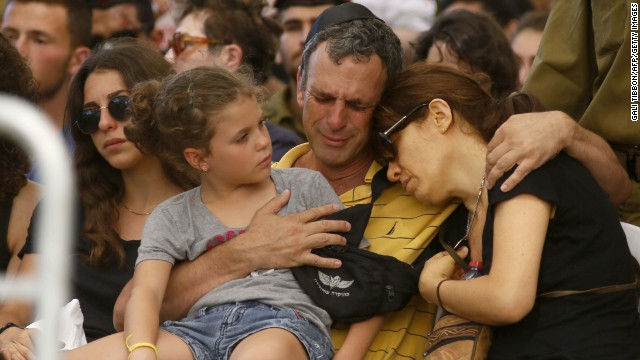 The parents and a sister of Israeli soldier Guy Algranati mourn during his funeral in Tel Aviv on July 31.