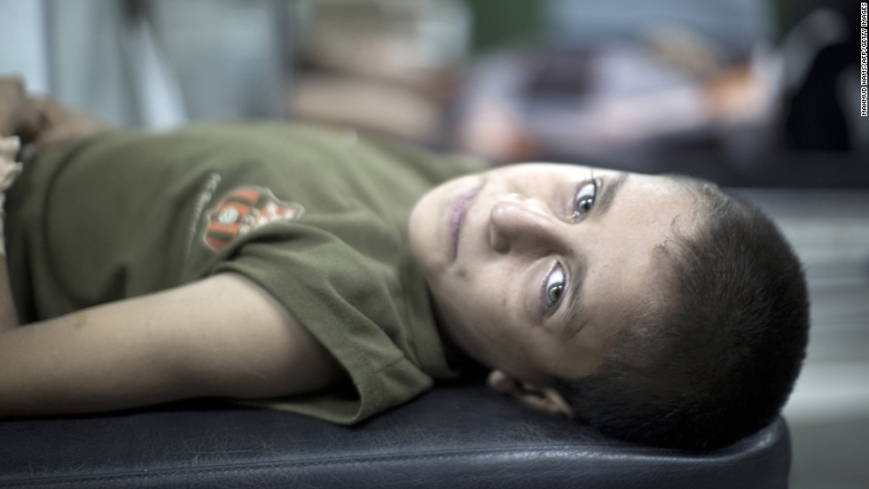 A Palestinian boy waits for treatment at a hospital in Beit Lahia after being wounded during an early morning airstrike <a href='http://www.cnn.com/2014/07/18/world/gallery/israel-gaza/index.html' target='_blank'>at a school-turned-shelter</a> in northern Gaza on Wednesday, July 30. The United Nations blamed Israel for the attack after <a href='http://www.cnn.com/2014/07/18/world/gallery/israel-gaza/index.html' target='_blank'>Israel launched a ground operation in Gaza</a> on Thursday, July 17, after a 10-day campaign of airstrikes failed to halt relentless Hamas rocket fire on Israeli cities.