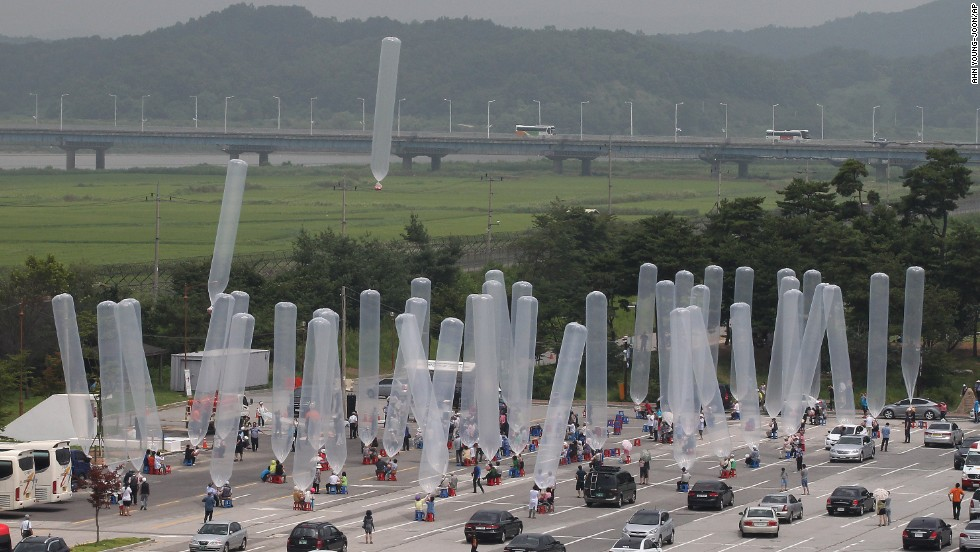 Activists release giant balloons carrying chocolate snacks, known as Choco Pies, for North Korea at the border village of Panmunjom, in South Korea.