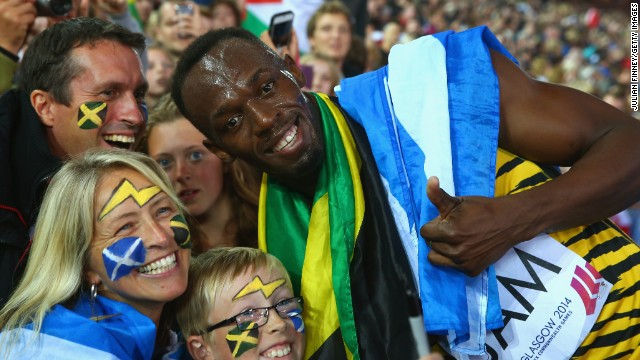 Usain Bolt delighted the crowd by posing for numerous pictures after his relay gold for Jamaica.
