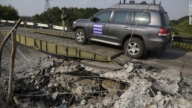 A convoy of international forensic experts and members of the mission for the Organization for Security and Co-operation in Europe travel across a damaged bridge near Debaltsevo village in Ukraine on Sunday, August 3, after clearing the area of the crash. The United States says a surface-to-air missile took down the Boeing 777 on Thursday, July 17, as it was flying over Ukraine from Amsterdam, Netherlands, to Kuala Lumpur, Malaysia, killing all 298 people aboard. Ukrainian officials have accused pro-Russian rebels of downing the jet, but Russia blames Ukraine's recent military operations against the rebels.