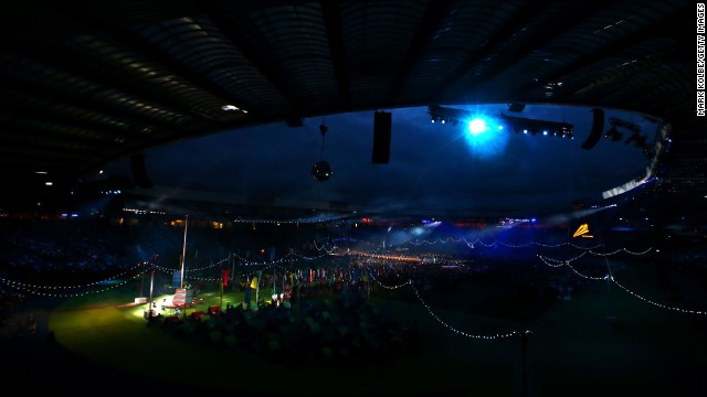 Fans look on as the Commonwealth Games Federation flag is lowered during the closing ceremony.