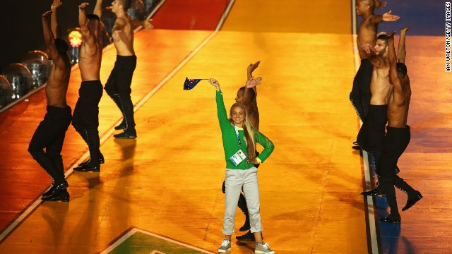 """Australian runner Genevieve LaCaze crashed the stage during Minogue's performance, dancing and waving an Australian flag before being removed by security. """"It was my 25th birthday,"""" she<a href='http://www.abc.net.au/local/photos/2014/08/04/4060171.htm' target='_blank'> told ABC</a>. """"I just saw the opportunity to get on stage with Kylie."""""""
