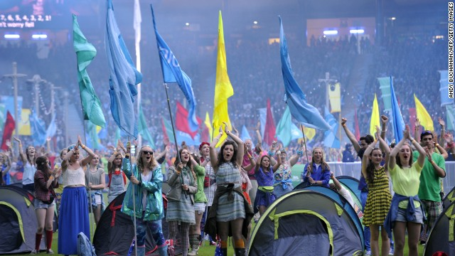 Volunteers hoist colorful flags to celebrate the games' end.