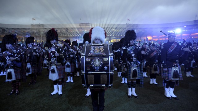 The Royal Edinburgh Military Tattoo performs. As many as 70,000 people attended the ceremony.