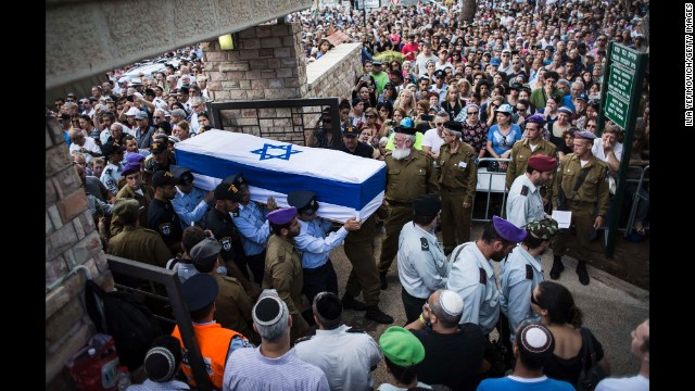 An honor guard caries the coffin of Israeli Lt. Hadar Goldin during his funeral in Kfar-saba, Israel, on August 3. Goldin was thought to have been captured during fighting in Gaza but was later declared killed in action by the Israel Defense Forces.