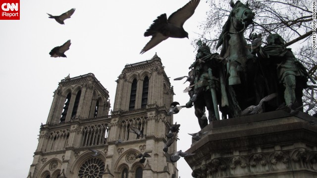 Pigeons are infamous residents in Paris, leaving their droppings on the city's famous monuments. These rock pigeons flew into <a href='http://ireport.cnn.com/docs/DOC-1153948 '>Doug Simonton</a>'s shot of the Notre Dame Cathedral.