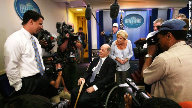 Brady visits the White House Briefing Room with his wife, Sarah, as White House Deputy Press Secretary Bill Burton, left, shows them around in June 2009.