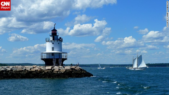 "This lighthouse is smaller than most, and it captured <a href='http://ireport.cnn.com/docs/DOC-1157099'>Mary Umbricht's</a> attention while visiting Portland, Maine. She is proud of the results: ""It was the combination of the clouds, blue sky, the sailboat and how they all came together that I liked about this photo."""