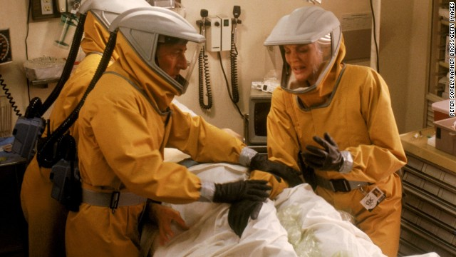 "In 1995's ""Outbreak,"" Dustin Hoffman and Rene Russo work to contain Motaba, a fictional disease similar to Ebola. The outbreak spreads from Africa to the United States via an infected monkey before a serum is created."