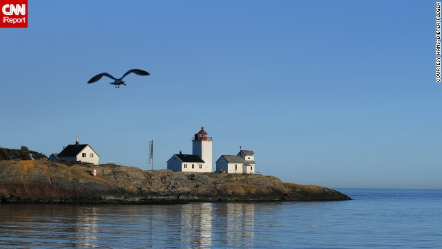 "The Langoytangen lighthouse in Langesund, Norway, was a favorite of <a href='http://ireport.cnn.com/docs/DOC-1157046'>Hans-Dieter Fleger</a>: ""'My family and I have often taken the children there to experience the sea. When we lived in Porsgrunn, I took photos of the lighthouse every time, but now - since we live in Atraa - it's rather rare."""
