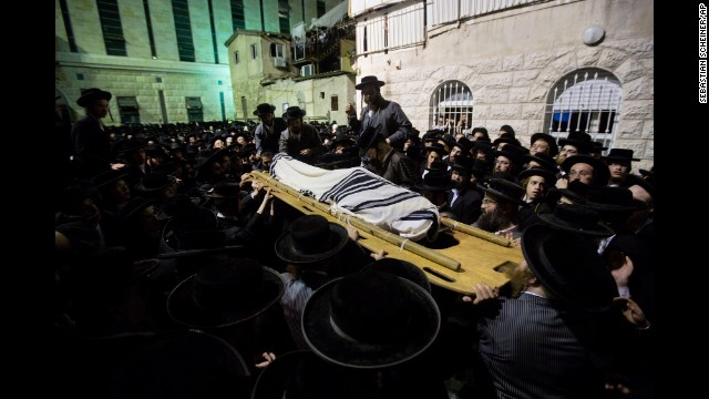 "The body of Avrohom Wallis is carried during his funeral in Jerusalem on Monday, August 4. Wallis was killed in what Israeli police spokesman Micky Rosenfeld called a ""terror attack,"" when a man drove an earthmover into a bus in Jerusalem."