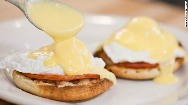 13. Spoon 1 to 2 tablespoons hollandaise over each egg. Serve, passing remaining hollandaise at table.